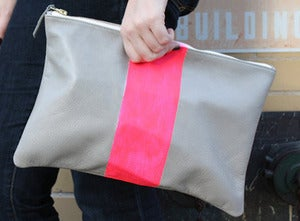 Image of neon vertical stripe clutch