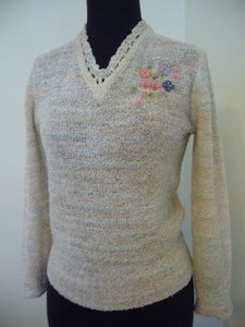 Image of embroidered bouclé knit sweater