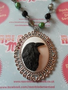 Image of Black Crow Bird Cameo Necklace on Rosary Style Green, Black, Dark Grey Clear Beads