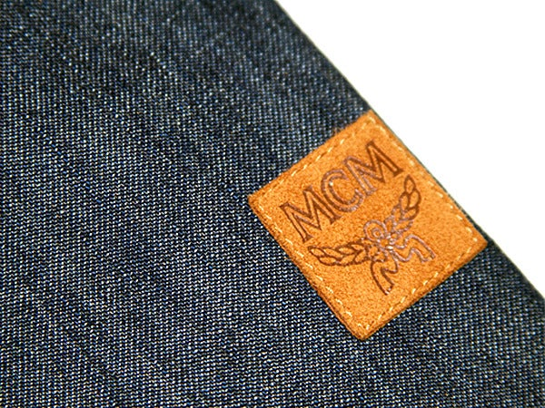 Image of Rare Vintage MCM Womens Denim Jacket w/ Removable Fur Collar designed by founder Michael Cromer