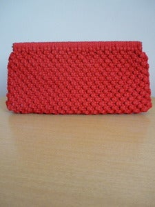 Image of red macramé clutch