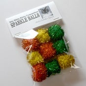 Image of Charlene Butterbean Approved Sparkle Balls in Orange, Yellow and Green