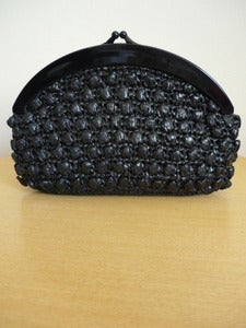 Image of black plastic raffia clutch