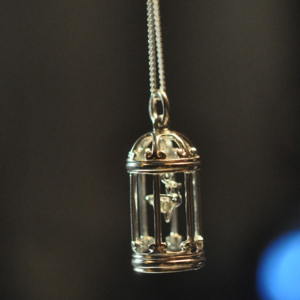 Image of Sterling silver birdcage with moving bird pendant
