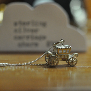 Image of Sterling silver carriage with moving wheels