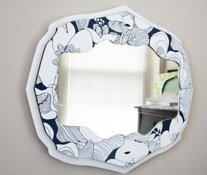Image of curly bracket mirror - blue bloom