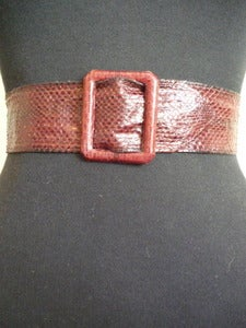 Image of maroon snakeskin belt