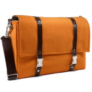 "Image of Larger 13"" laptop messenger bag with leather strap in orange with brown leather"