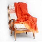 Image of tangerine mohair blanket