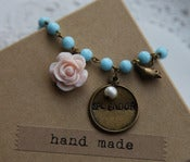 "Image of Handstamped ""Splendor"" Charm on Vintage Aqua Blue Glass Bead Chain"