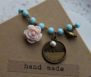 "Image of Handstamped ""Splendor"" Charm on Aqua Blue Glass chain"