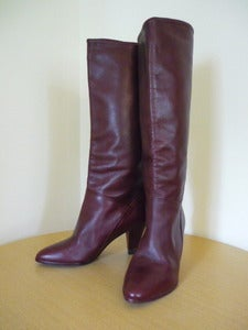 Image of burgundy leather knee high boots