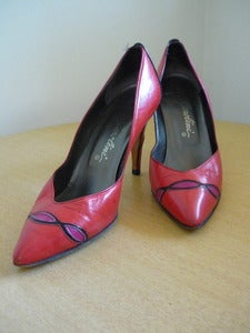 Image of red colorblock leather pumps