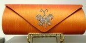 Image of Haute Latitude orange crystal butterfly clutch