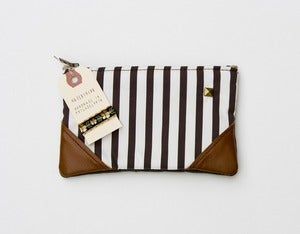 Image of -SOLD OUT- a small chocolate + vanilla striped zipper pouch with leather corners 