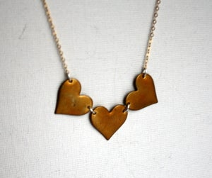 Image of Three Brass Hearts