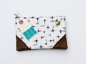 Image of -SOLD OUT- a small brushstrokes crosses print zipper purse with leather corners and a METAL zipper