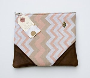 Image of -SOLD OUT- a chevron striped zipper clutch with leather corners and a METAL zipper