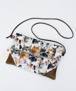 Image of -SOLD OUT- a foldover clutch in CATS! print with a removable strap!