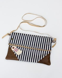 Image of -SOLD OUT- a foldover clutch in navy + cream stripe with a removable strap!