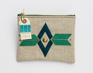 Image of large zipper pouch with geometric leather appliques and a metal zipper (a)