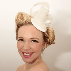 Image of Bridal fascinator with embellishment and beautiful Swarovski crystals.