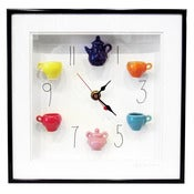 Image of Multicolor Tea Set Clock with Numbers by Carlos Silva