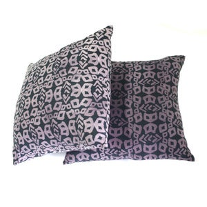 Image of blueish black and purple printed pillow