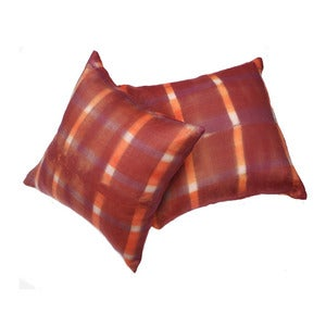 Image of orange and purple plaid pillow