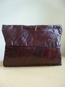 Image of dark brown eelskin envelope clutch