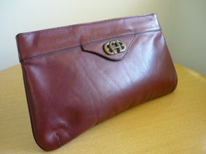 Image of Aigner red-brown leather clutch