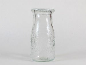 Image of Antique Recycled Glass Milk Bottles