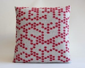 Image of reworked hex bubblegum/raspberry cushion