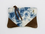 Image of small hand bleached denim zip pouch with leather corners + a METAL zipper