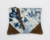 Image of medium sized hand bleached denim zip pouch with leather corners + a METAL zipper