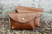 Image of leather pouch, tan