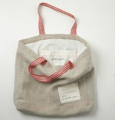 Image of Natural Linen tote bag with red hangers