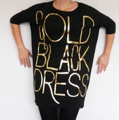 Image of gold black dress