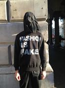 Image of FASHION IS FAKE BLACK JUMPER
