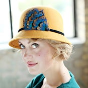 Image of Mustard Womens Cloche Hat With Peacock Blue Feather Accent