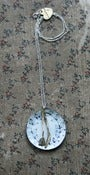 Image of knife and fork on an enamel plate necklace