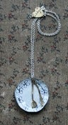 Image of Knife and fork on an enamel plate (with flowers) necklace