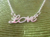 Image of Silver Coloured Metal LOVE Word Necklace Retro Girly Kitsch Romance