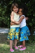 Image of Blue and Yellow flower print girls ruffle skirt sz 3-7 yrs!