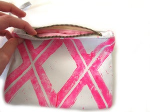 Image of Small neon pink Xs hand-printed leather pouch