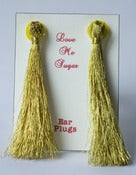 Image of Long tassel Breakfast at Tiffanys earplugs in silver or gold lurex