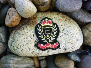 Image of Vintage College Emblem Blazer Patch in Black Felt with Gold / Silver / Red and Black embroidery.
