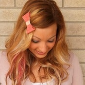 Image of the lil' leather bow- coral pattern leather bow barrette