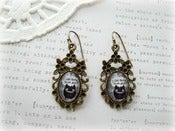 Image of Antique Brass Floral Framed Earrings with Black Monster Picture