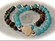 Image of Buddha in turquoise and tiger's eye